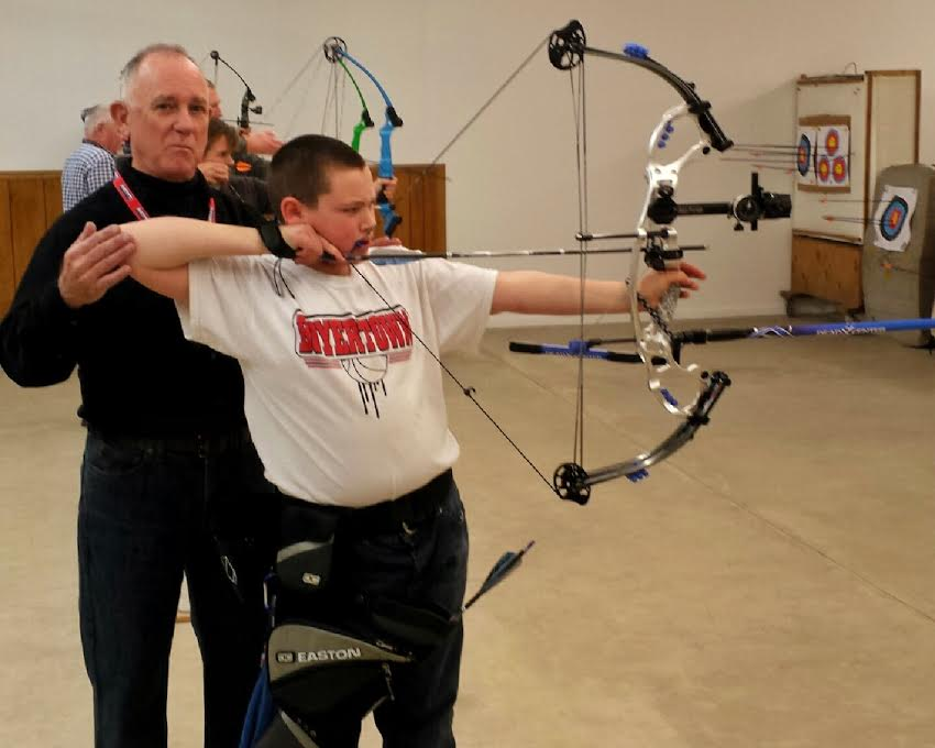Coach Mike leading the Stowe Archers Free Youth Archery Program